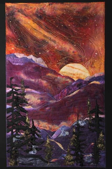 """Cosmic Moon Over the Mountain"" by Hub artist Linda Hoffmeister is part of 2 year, national and international traveling exhibit ""Fly Me To The Moon"" marking the 50th anniversary of man's moon landing. The exhibit was featured at the Library of Congress, Washington DC for the month of October 2017. It is also one of 11 pieces selected for the magazine Machine Quilting Unlimited, March/April 2017 edition."